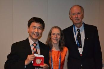 Kelin Wang accepting JT Wilson medal
